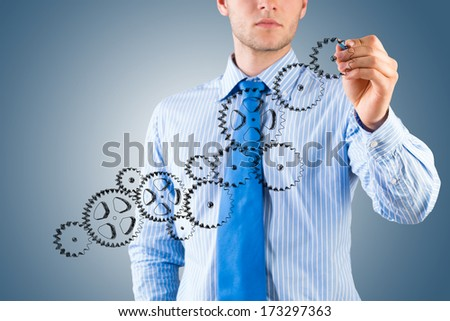 businessman drawing a sketch of the mechanism, create a successful business concept - stock photo