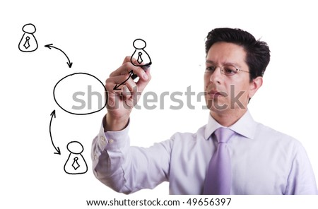 businessman drawing a social network scheme on a whiteboard (selective focus) - stock photo