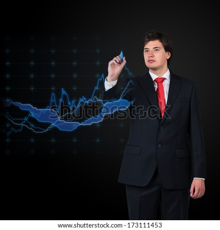 Businessman drawing a stock exchange graph - stock photo