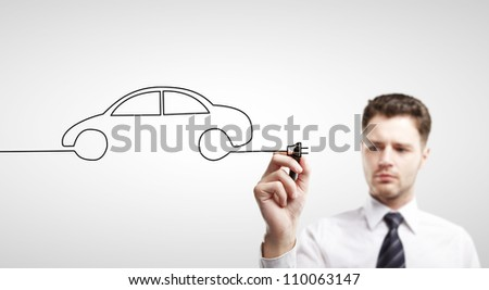 businessman drawing abstract car - stock photo