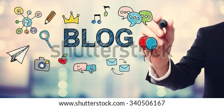 Businessman drawing Blog concept on blurred abstract background  - stock photo