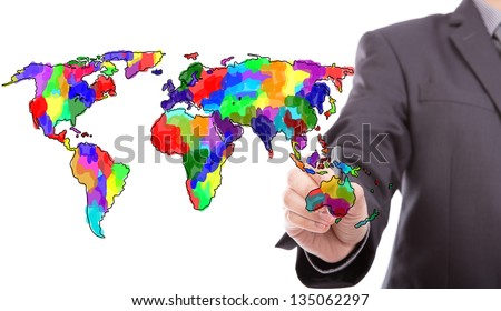 Businessman drawing colorful map of world - stock photo