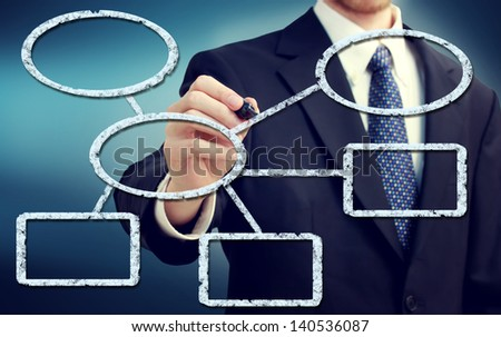 Businessman drawing flowchart with a blue background - stock photo