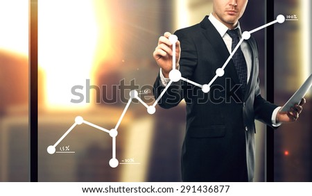 businessman drawing graph, close up - stock photo