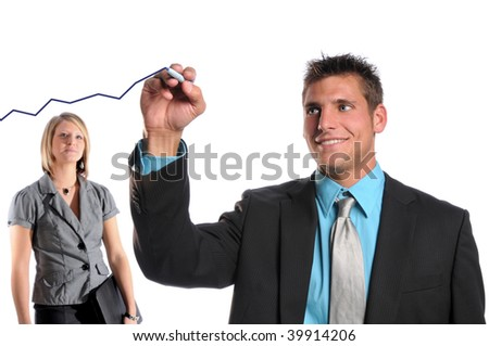 Businessman drawing growth chart on glass while woman looks - stock photo