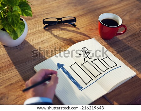 Businessman Drawing Growth Concept on a Note Pad - stock photo