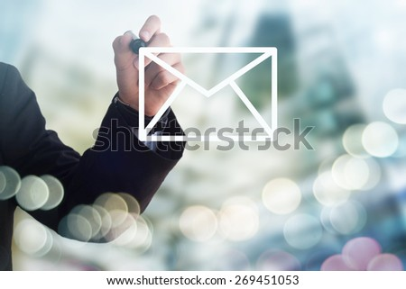 Businessman drawing mail envelope - stock photo