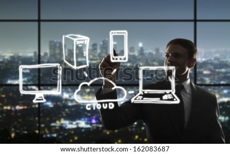 businessman drawing network cloud in office - stock photo