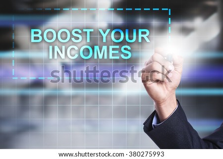 "Businessman drawing on virtual screen ""Boost your incomes"".  - stock photo"