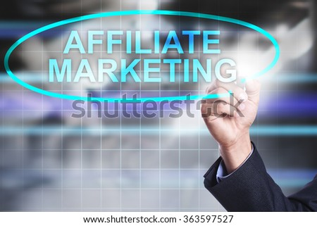 """Businessman drawing on virtual screen text """"Affiliate marketing"""". Business concept. Internet concept. - stock photo"""