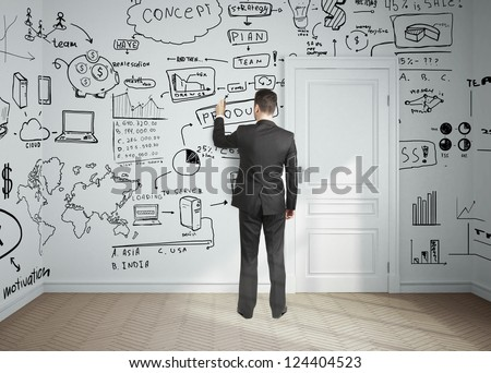 businessman drawing plan business concept on wall - stock photo