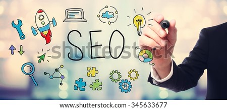 Businessman drawing SEO concept on blurred abstract background  - stock photo