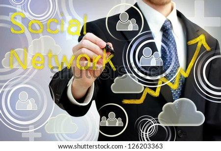 Businessman drawing social network with rising arrows - stock photo
