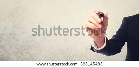 Businessman drawing something with a black marker - stock photo