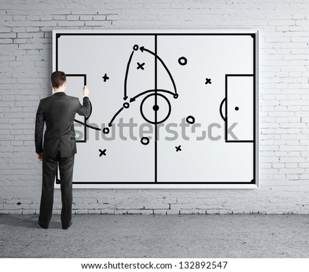 businessman drawing tactic scheme on  board - stock photo