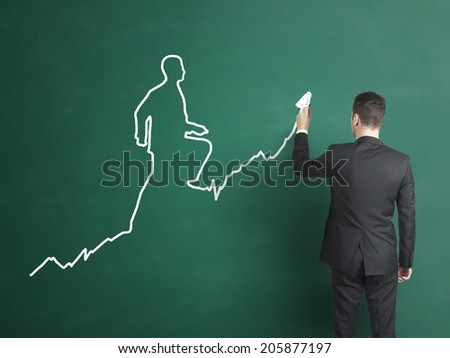 businessman drawing  the chart in the form of a walking man - stock photo