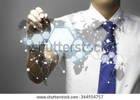 Businessman drawing the world network connection on whiteboard - stock photo