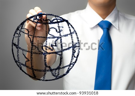 Businessman drawing the world on whiteboard - stock photo