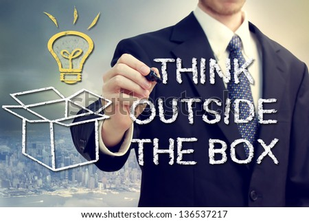 Businessman drawing thinking outside the box theme - stock photo