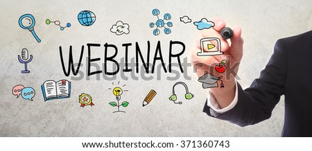 Businessman drawing Webinar concept with a marker - stock photo