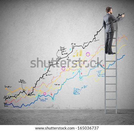 Businessman draws colorful statistics on a stairs - stock photo