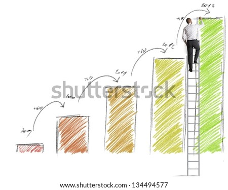 Businessman draws prevision of statistics - stock photo