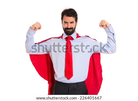 Businessman dressed like superhero proud of himself - stock photo