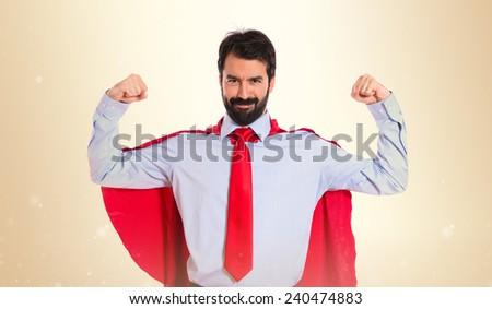 Businessman dressed like superhero proud of himself - stock photo