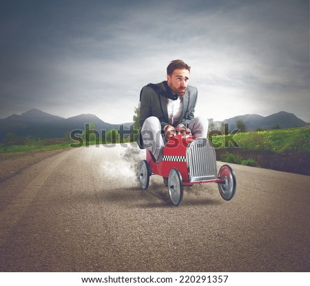 Businessman driving a fast car in a street - stock photo