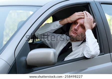 Businessman driving feeling disappointed and unhappy. - stock photo