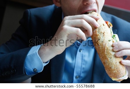 businessman eating lunch - stock photo