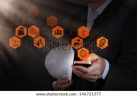 businessman engineer hand use smart phone computer as concept - stock photo