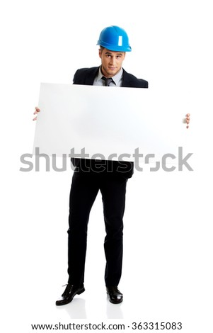 Businessman enginner holding empty banner. - stock photo