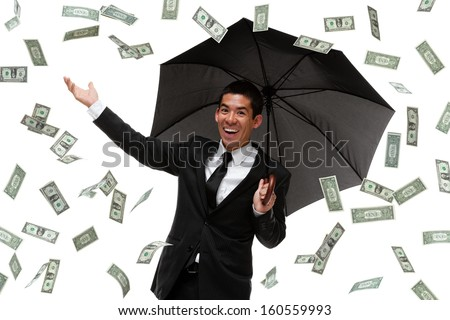 Businessman enjoying it raining money - stock photo
