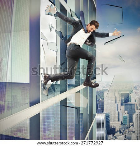 Businessman escapes by jumping off a skyscraper - stock photo