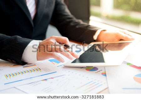 Businessman  examine finance, tax, accounting, statistics and analytic research concept - stock photo