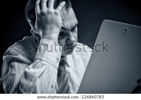 Businessman examining documents. Its results are disappointing - stock photo