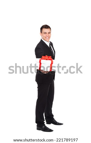 Businessman excited happy smile hold gift box in hand. Business man present red gift box with ribbon bow full length isolated over white background - stock photo