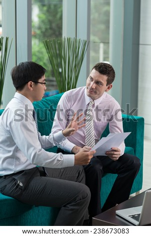 Businessman explaining his idea to the colleague - stock photo