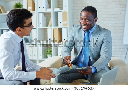 Businessman explaining terms of cooperation - stock photo
