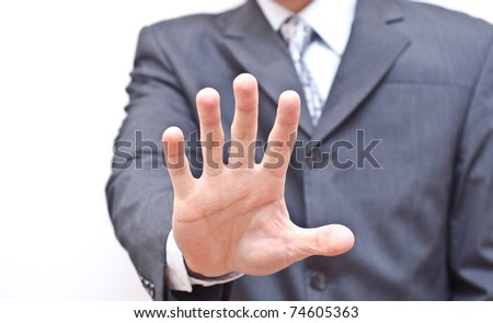 Businessman expressing refusal with open hand - stock photo