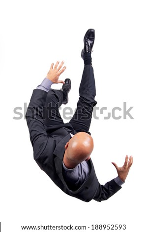 Businessman falling isolated in white - stock photo
