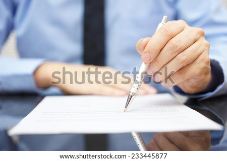 businessman find insurance scam in contract - stock photo