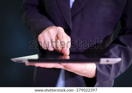 Businessman finger touching screen of a digital tablet  - stock photo