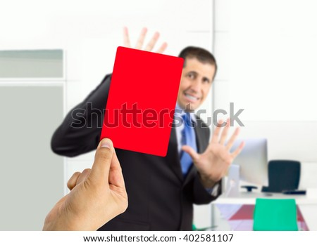 businessman fired by his boss with a red card - stock photo