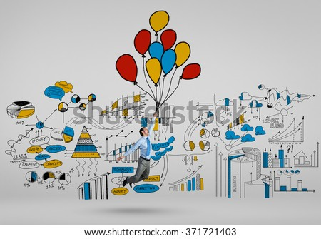 Businessman fly on balloons - stock photo