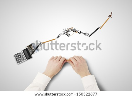 businessman folded graph of everyday items - stock photo
