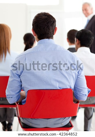 Businessman from behind at a conference in the office - stock photo
