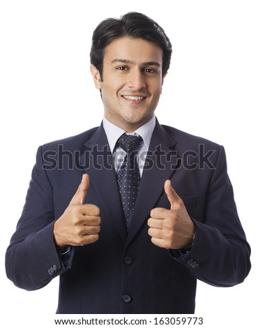 Businessman gesturing thumbs up - stock photo