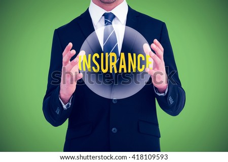 Businessman gesturing with his hands against green background - stock photo